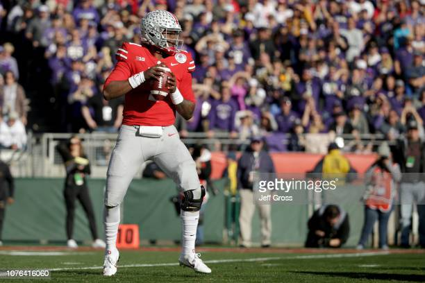 Dwayne Haskins of the Ohio State Buckeyes throws the ball in the first half against the Washington Huskies in the Rose Bowl Game presented by...