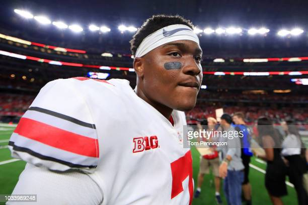 Dwayne Haskins of the Ohio State Buckeyes walks off the field after beating the TCU Horned Frogs 4028 during The AdvoCare Showdown at ATT Stadium on...