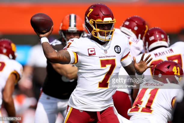 Dwayne Haskins of the Washington Football Team looks to throw a pass against the Cleveland Browns during the first quarter in the game at FirstEnergy...