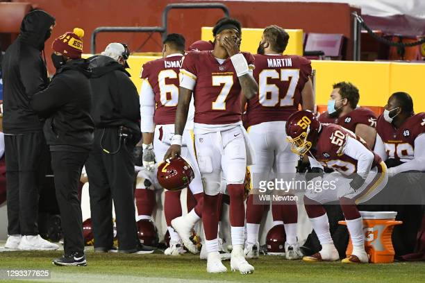 Dwayne Haskins of the Washington Football Team reacts on the sideline against the Carolina Panthers during the fourth quarter at FedExField on...