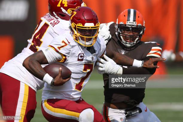 Dwayne Haskins of the Washington Football Team tries to avoid a tackle while playing the Cleveland Browns at FirstEnergy Stadium on September 27 2020...