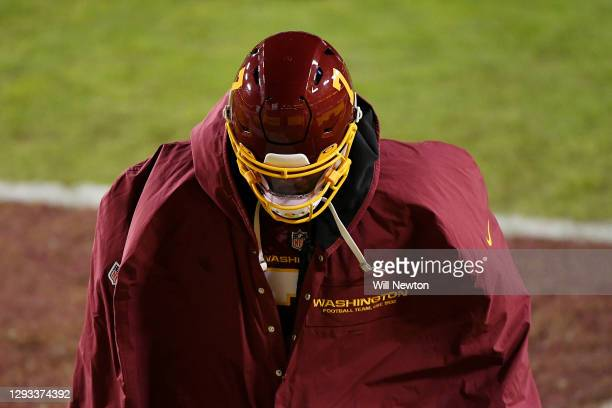 Dwayne Haskins of the Washington Football Team walks off the field after losing to the Carolina Panthers 20-13 at FedExField on December 27, 2020 in...