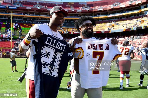 Dwayne Haskins of the Washington Redskins and Ezekiel Elliott of the Dallas Cowboys pose for a picture after swapping jerseys at the end of the game...