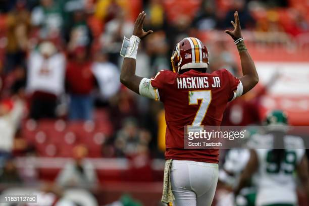 Dwayne Haskins of the Washington Redskins celebrates after Derrius Guice scores a touchdown against the New York Jets during the second half at...
