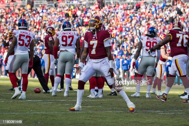 Dwayne Haskins of the Washington Redskins celebrates after throwing a pass for a touchdown against the New York Giants during the first half at...