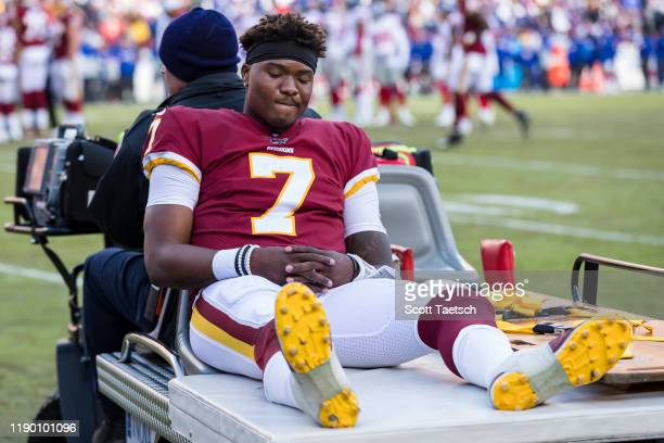 Dwayne Haskins of the Washington Redskins is carted off the field after an injury during the second half of the game against the New York Giants at...