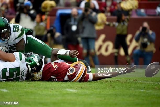 Dwayne Haskins of the Washington Redskins is sacked by Frankie Luvu of the New York Jets during the second half at FedExField on November 17 2019 in...