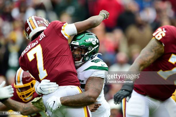Dwayne Haskins of the Washington Redskins is tackled by Quinnen Williams of the New York Jets after throwing a pass in the first quarter at...