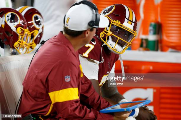 Dwayne Haskins of the Washington Redskins looks up at the scoreboard while sitting on the bench during the third quarter of the game against the...