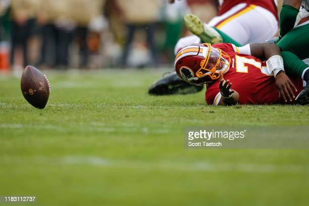 Dwayne Haskins of the Washington Redskins reacts after being sacked and losing the ball against the New York Jets during the second half at...