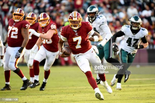 Dwayne Haskins of the Washington Redskins runs against the Philadelphia Eagles during the second half at FedExField on December 15 2019 in Landover...