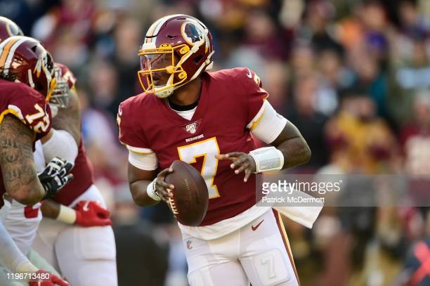Dwayne Haskins of the Washington Redskins scrambles with the ball in the first half against the New York Giants at FedExField on December 22 2019 in...