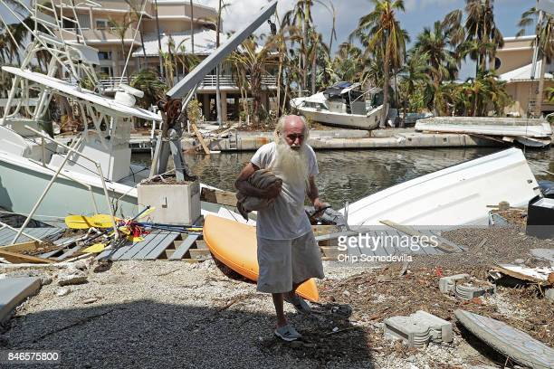 Dwayne Hope walks around the dock where his boat background was moored before it was blown across the channel by Hurricane Irma on Big Pine Key...