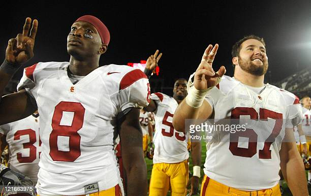 Dwayne Jarrett and Ryan Kalil of USC flash the Fight On sign in celebration after the Pacific10 Conference football game between USC and Stanford at...
