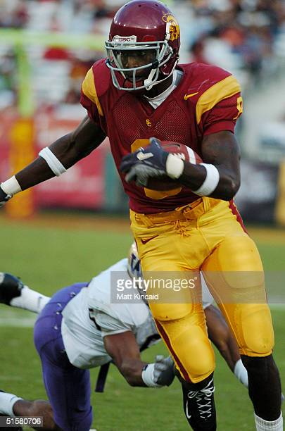 Dwayne Jarrett of the University of Southern California Trojans runs with the ball in the third quarter against the Washington Huskies on October 23,...
