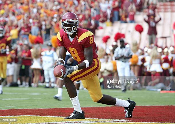 Dwayne Jarrett of the USC Trojans celebrates in the end zone during the game with the Arizona Wildcats at the Los Angeles Colliseum on October 8,...