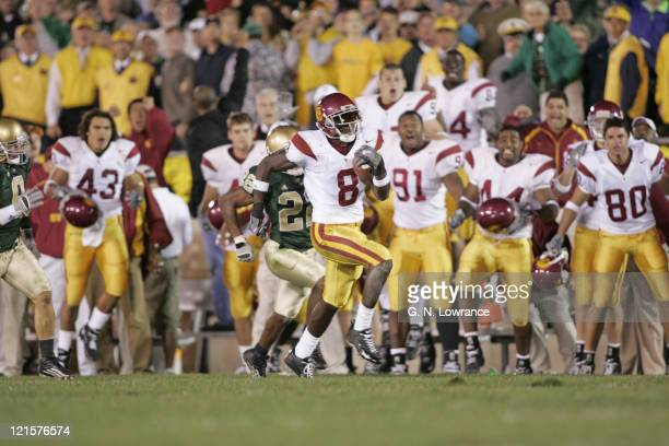 Dwayne Jarrett of the USC Trojans makes a 61-yard reception on 4th and 9 during a game against the Notre Dame Irish at Notre Dame Stadium in South...