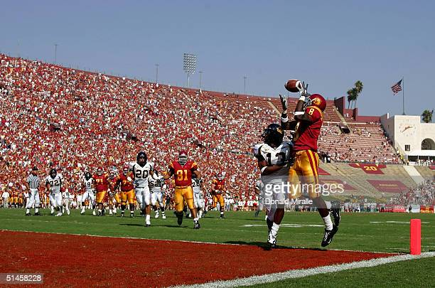 Dwayne Jarrett of the USC Trojans over Daymeion Hughes of the California Golden Bears in the endzone that was called back because of a penalty during...