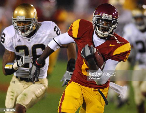 Dwayne Jarrett of USC scores on a 43-yard touchdown reception in the fourth quarter of 44-24 victory over Notre Dame at the Los Angeles Memorial...