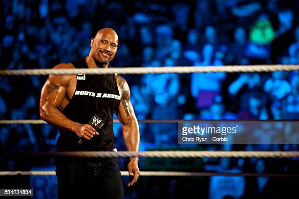 Dwayne Johnson, aka The Rock, enters the ring to talk smack about his upcoming opponent John Cena during the WWE Raw event at Rose Garden arena in...