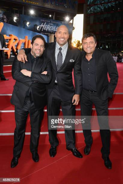 Dwayne Johnson and Brett Ratner and Sven Sturm attend the Europe premiere of Paramount Pictures 'Hercules' at CineStar on August 21 2014 in Berlin...