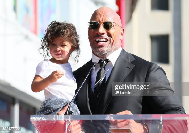 Dwayne Johnson and daughter Jasmine Johnson attend a ceremony honoring him with a star on The Hollywood Walk of Fame on December 13 2017 in Los...