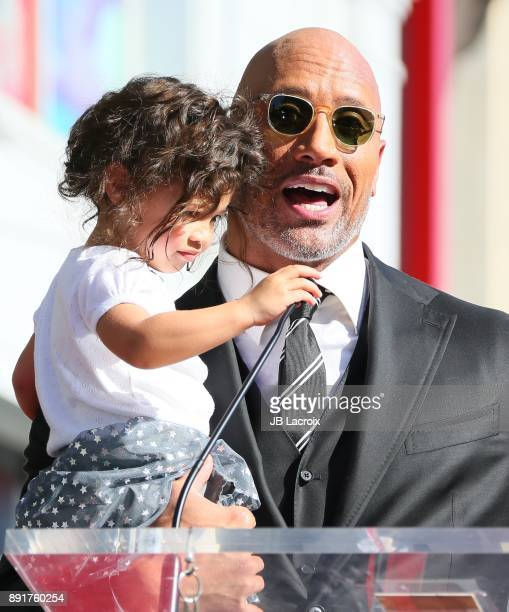 Dwayne Johnson and daughter Jasmine Johnson attends a ceremony honoring him with a star on The Hollywood Walk of Fame on December 13 2017 in Los...