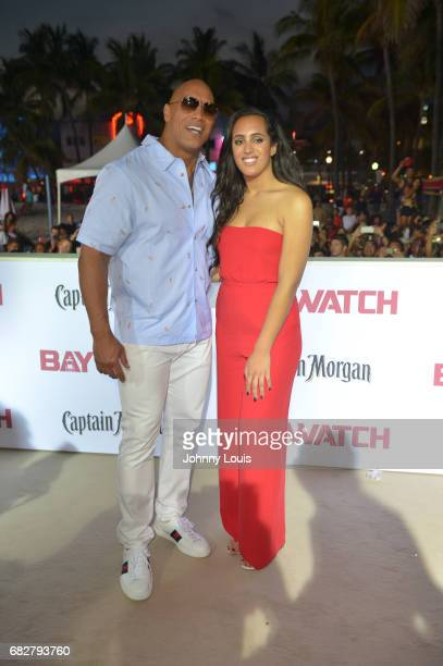 Dwayne Johnson and daughter Simone Alexandra Johnson attend Paramount Pictures' World Premiere of 'Baywatch' on May 13 2017 in Miami Beach Florida