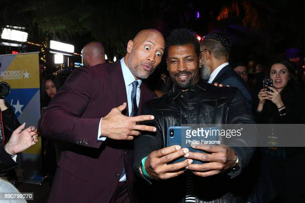 Dwayne Johnson and Deon Cole attend the premiere of Columbia Pictures' Jumanji Welcome To The Jungle on December 11 2017 in Hollywood California