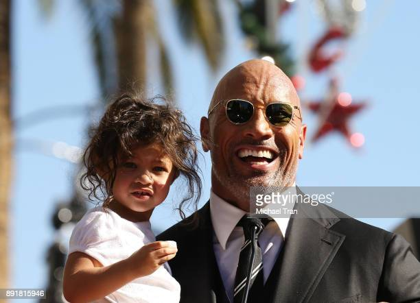 Dwayne Johnson and his daughter Jasmine Johnson attend the ceremony honoring him with a Star on The Hollywood Walk of Fame held on December 13 2017...