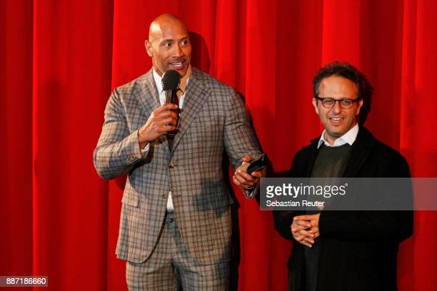 Dwayne Johnson and Jake Kasdan attend the German premiere of 'Jumanji Willkommen im Dschungel' at Sony Centre on December 6 2017 in Berlin Germany