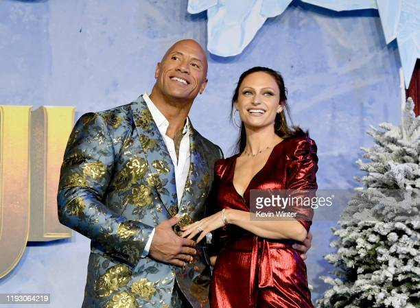 "Dwayne Johnson and Lauren Hashian arrive at the premiere of Sony Pictures' ""Jumanji: The Red Carpet"" on December 09, 2019 in Hollywood, California."