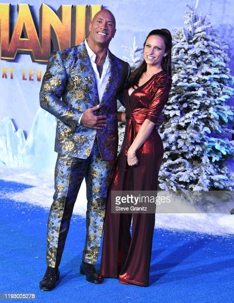 "Dwayne Johnson and Lauren Hashian arrives at the Premiere Of Sony Pictures' ""Jumanji: The Next Level"" on December 09, 2019 in Hollywood, California."