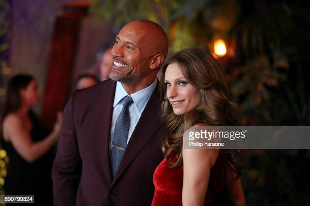 "Dwayne Johnson and Lauren Hashian attend the premiere of Columbia Pictures' ""Jumanji: Welcome To The Jungle"" on December 11, 2017 in Hollywood,..."