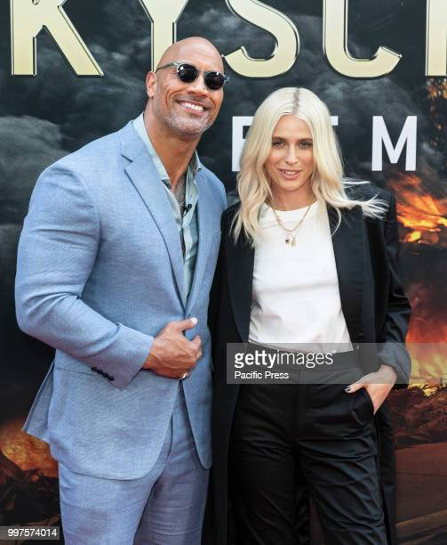 Dwayne Johnson and Lauren Wasser attend the premiere of Skyscraper at AMC Loews Lincoln Center