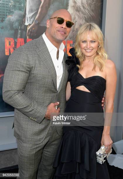 Dwayne Johnson and Malin Akerman attend the premiere of Warner Bros Pictures' 'Rampage' at Microsoft Theater on April 4 2018 in Los Angeles California