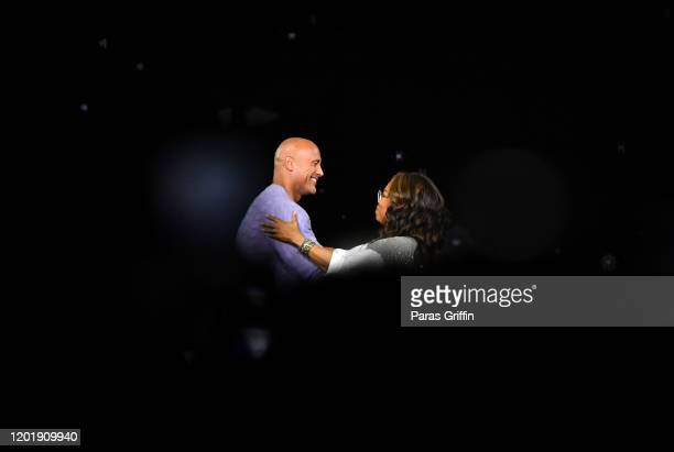 Dwayne Johnson and Oprah Winfrey onstage during Oprah's 2020 Vision Your Life in Focus Tour presented by WW at State Farm Arena on January 25 2020 in...