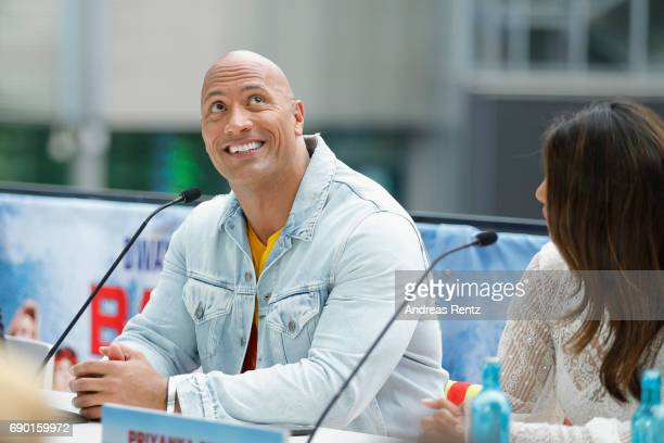 Dwayne Johnson and Priyanka Chopra are seen on stage at the 'Baywatch' Photo Call at Sony Centre on May 30 2017 in Berlin Germany