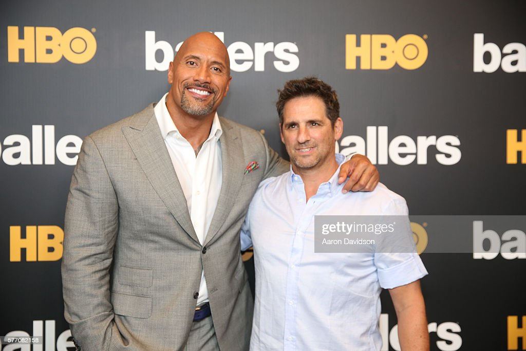 Dwayne Johnson (L) and series creator Stephen Levinson attend the HBO Ballers Season 2 Red Carpet Premiere and Reception on July 14, 2016 at New World Symphony in Miami Beach, Florida.