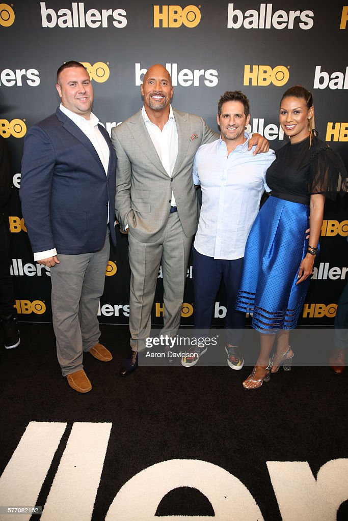 Dwayne Johnson (2L) and series creator Stephen Levinson (3L) attend the HBO Ballers Season 2 Red Carpet Premiere and Reception on July 14, 2016 at New World Symphony in Miami Beach, Florida.