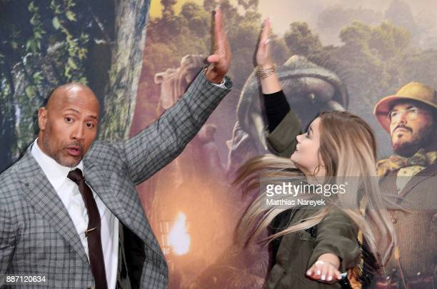 Dwayne Johnson and Youtuber Julia Beautx arrive for the German premiere of 'Jumanji: Willkommen im Dschungel' at Sony Center on December 6, 2017 in...