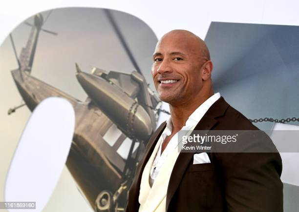 Dwayne Johnson arrives at the premiere of Universal Pictures' Fast Furious Presents Hobbs Shaw at Dolby Theatre on July 13 2019 in Hollywood...