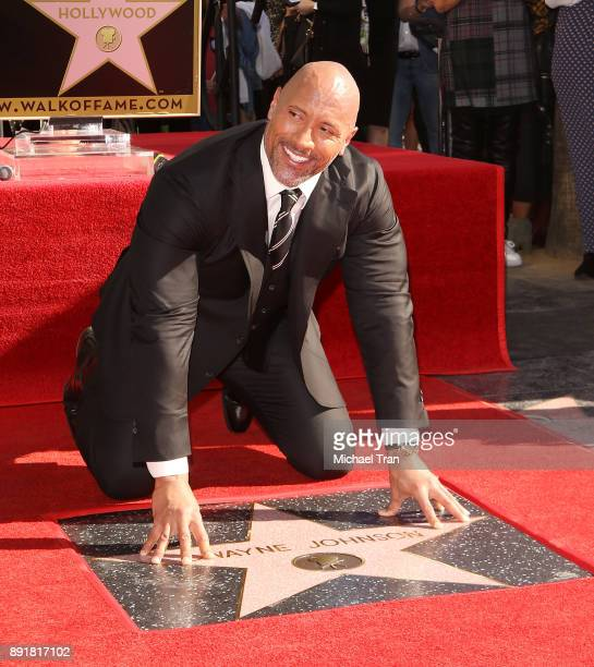 Dwayne Johnson attends the ceremony honoring him with a Star on The Hollywood Walk of Fame held on December 13 2017 in Hollywood California