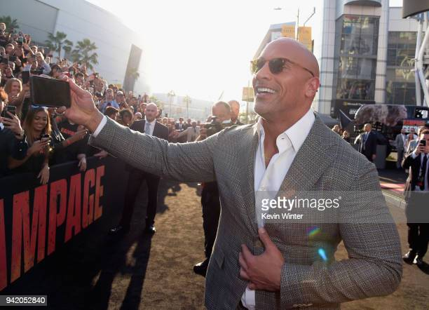 Dwayne Johnson attends the premiere of Warner Bros Pictures' 'Rampage' at Microsoft Theater on April 4 2018 in Los Angeles California