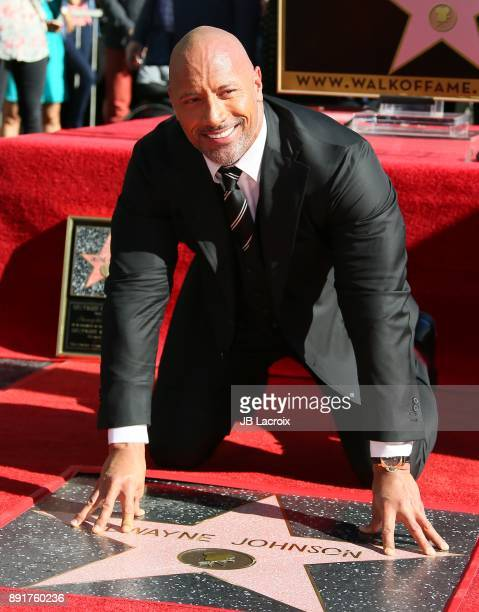 Dwayne Johnson is honored with a star on The Hollywood Walk of Fame on December 13 2017 in Los Angeles California