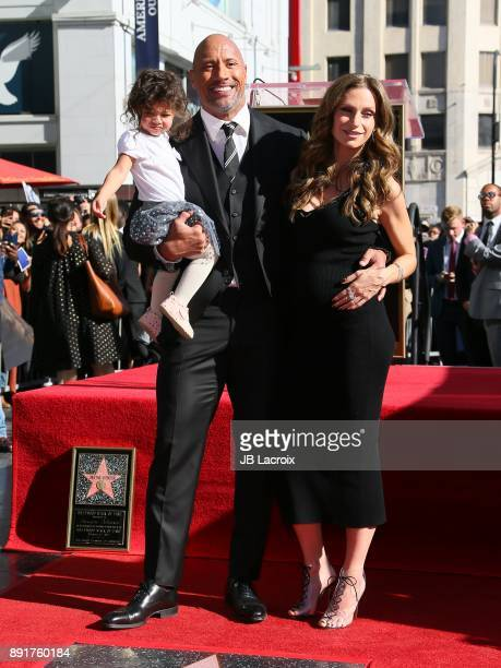 Dwayne Johnson Lauren Hashian and daughter Jasmine Johnson attend a ceremony honoring him with a star on The Hollywood Walk of Fame on December 13...