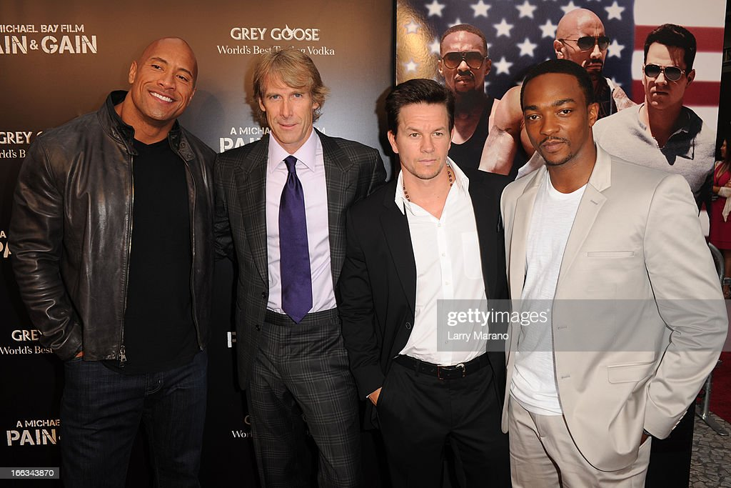Dwayne Johnson, Michael Bay, Mark Wahlberg and Anthony Mackie attend the 'Pain & Gain' premiere on April 11, 2013 in Miami Beach, Florida.