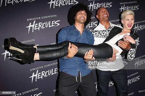 Dwayne Johnson MTV VJ Krit Schmidt and Kate Peck arrives at the screening of HERCULES at Event Cinemas George Street on June 19 2014 in Sydney...