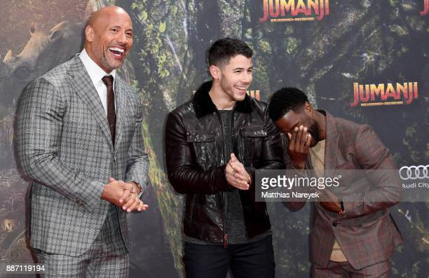 Dwayne Johnson Nick Jonas and Kevin Hart arrive for the German premiere of 'Jumanji Willkommen im Dschungel' at Sony Center on December 6 2017 in...