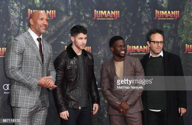 Dwayne Johnson Nick Jonas Kevin Hart and Jake Kasdan arrive for the German premiere of 'Jumanji Willkommen im Dschungel' at Sony Center on December 6...